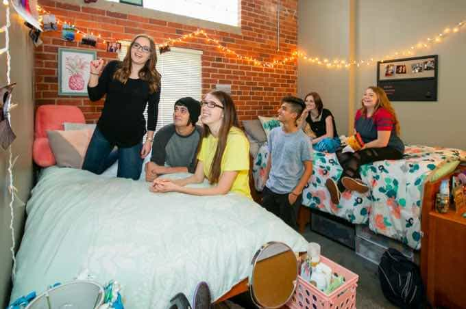 Group of students hanging out in a residence hall room