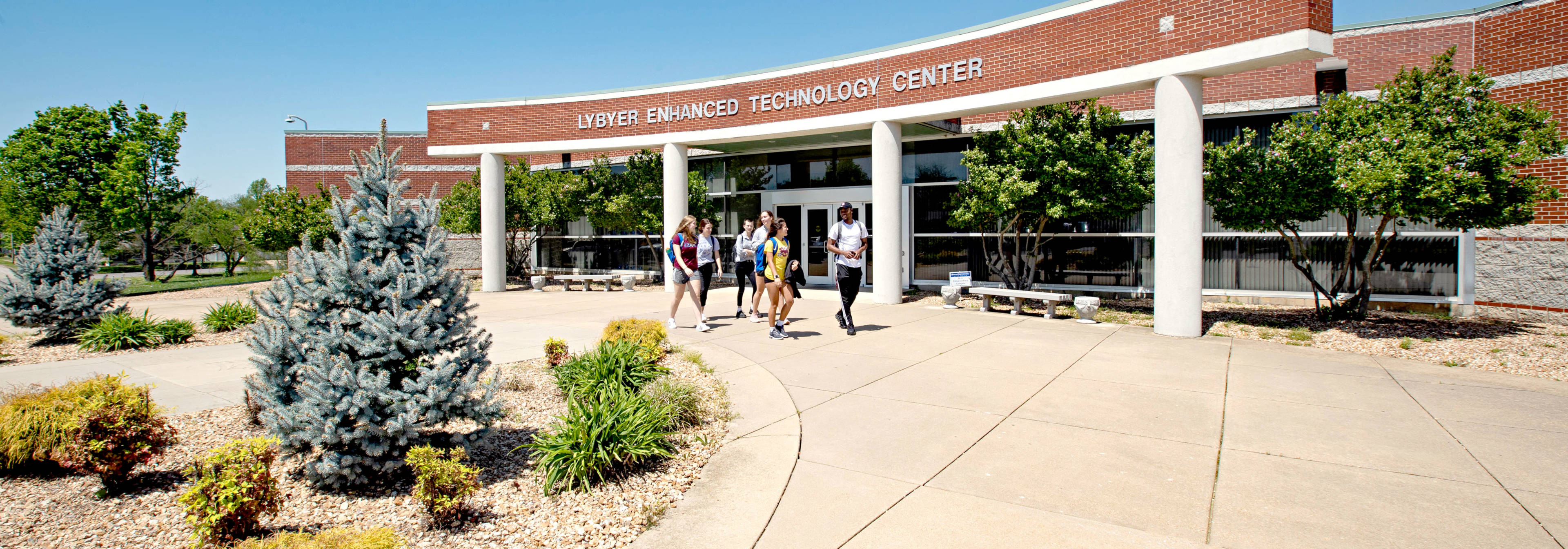 Students in early Summer in front of the Lybyer technology building