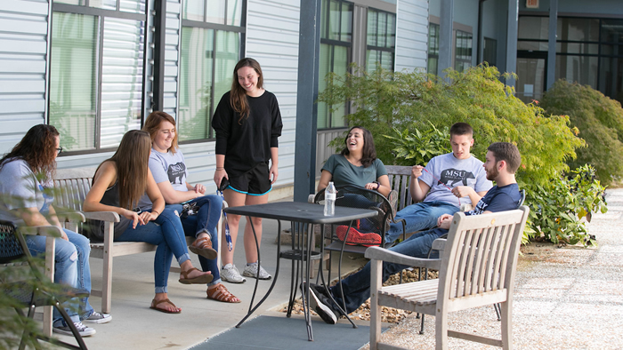 Students enjoying one of the courtyards at the Grizzly Lofts.