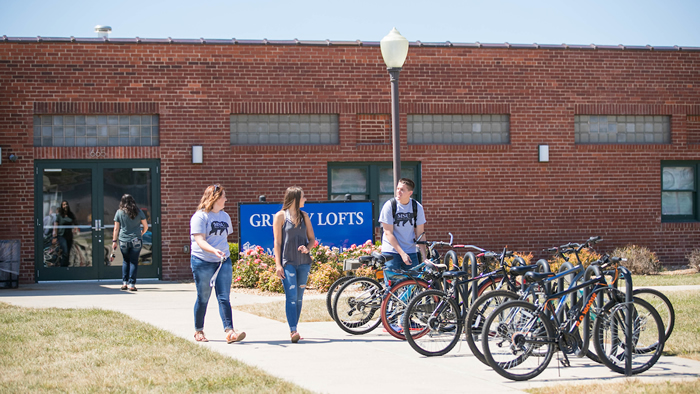 Students utilize the bike rack outside of the Grizzly Lofts