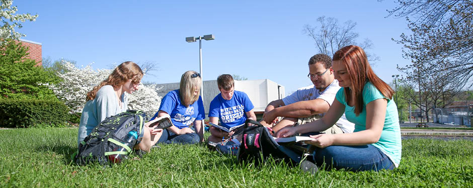 Students take advantage of a nice day to study outdoors.